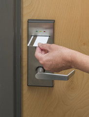 Keycard being inserted in electronic hotel door lock