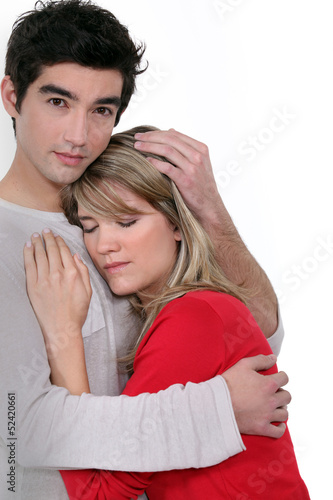 A man comforting his girlfriend.