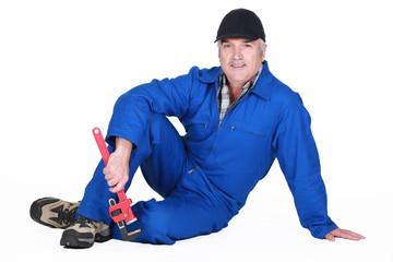 A mature plumber.