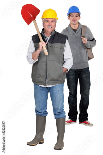 Construction worker and his apprentice