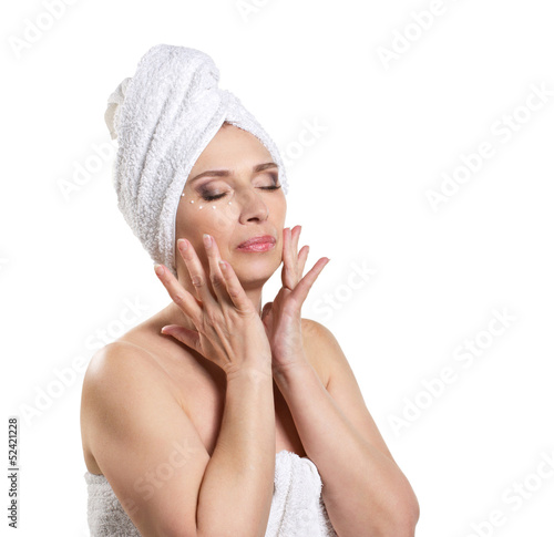woman applying cream for face