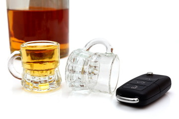 concept of drunk driver with  whiskey, glasses, car keys