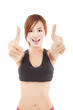 happy young fitness woman with thumbs up