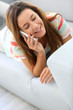 Relaxed brunette girl talking on the phone