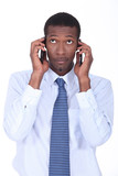 Businessman holding two telephones