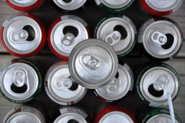 Cans of soda, juice drink and beer