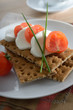 Snack with mozzarella and crisp bread