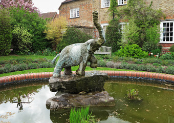 Statue of an elephant in a garden pond