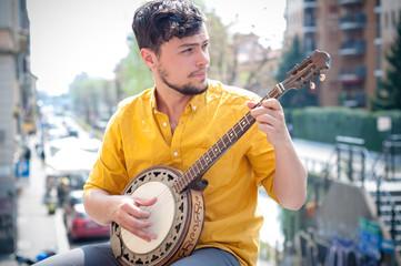 hipster young man playing banjo