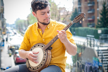 hipster young man playing banjo