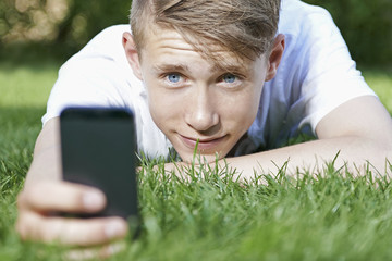 Young man relaxing and use a smartphone