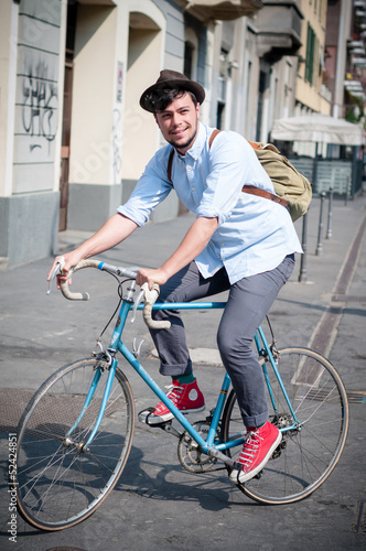hipster young man on bike