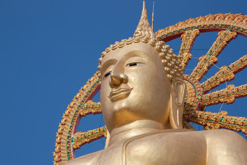 Statue of Buddha on blue sky background