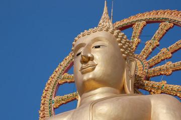 Statue of Buddha on blue sky background