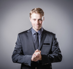 man holds his hands folded