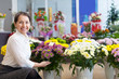 Happy  woman with chrysanthemum at  store