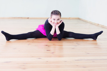 young dancer on the floor