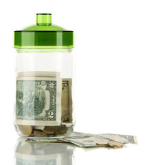 Glass jar with money isolated on white
