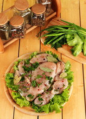 Chicken meat on wooden board,herbs and spices on wooden table