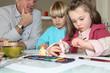 Children painting plaster models