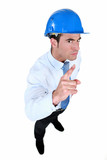 helmeted foreman with threatening look