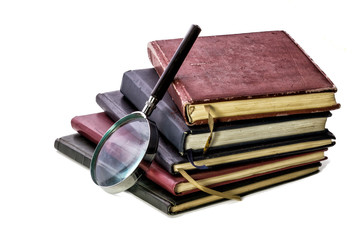 Books and Magnifying Glass. On White Background