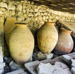 Ancient clay pots and mosaic excavations into Greek town ruins