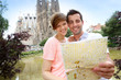 Couple reading map in front of the Sagrada familia church