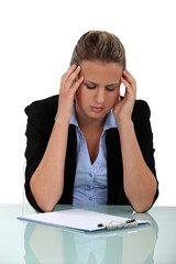 office worker suffering from headache