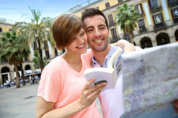 Tourists reading map in the Plaza Real of Barcelona