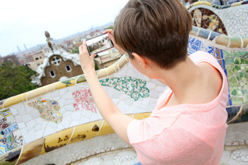 Girl taking picture of Barcelona from Guell Park