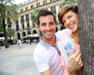 Cheerful couple of tourists at the Plaza Real de Barcelona