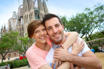 Couple standing by the Sagrada familia church, Spain