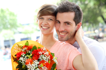 Girl receiving flowers from boyfriend