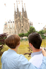 Tourists looking at the Sagrada Familia church