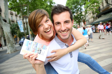 Cheerful couple in La Rambla of Barcelona