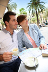 Couple in Barcelona sitting at restaurant table in Plaza Real