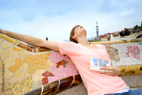 Young woman relaxing in Guell park