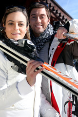 Couple going skiing on a sunny winter's day