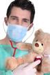 doctor listening to teddy bear heartbeat
