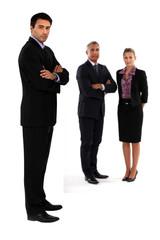 Three businesspeople stood together