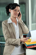 Business-worker looking at document during call