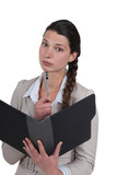 Businesswoman with an open folder