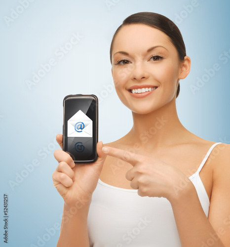 woman with smartphone and email icon