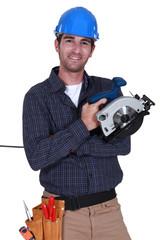 Handyman holding a circular saw.