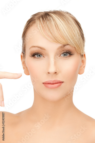 woman pointing at her face