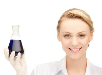 female chemist holding bulb with chemicals
