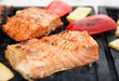 Salmon steaks being fried on grill