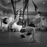 Fotoroleta Fitness TRX training exercises at gym woman and man