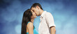 Beautiful couple kissing on blue sky background